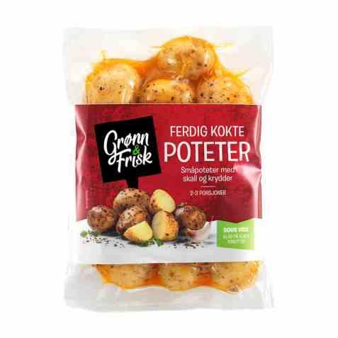 Bilde av Grønn og frisk ferdig kokte poteter med skall og krydder.