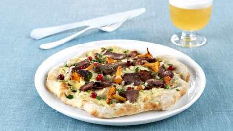 Bilde av Eltefri pizza med reinsdyrskav, bacon og kantareller.